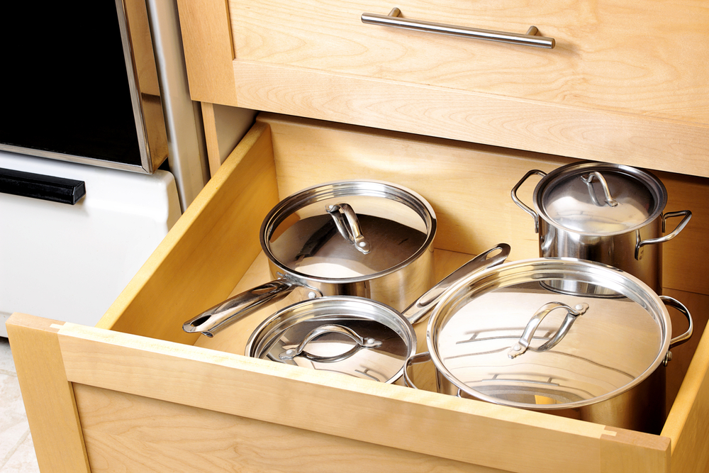 drawer full of pots and pans