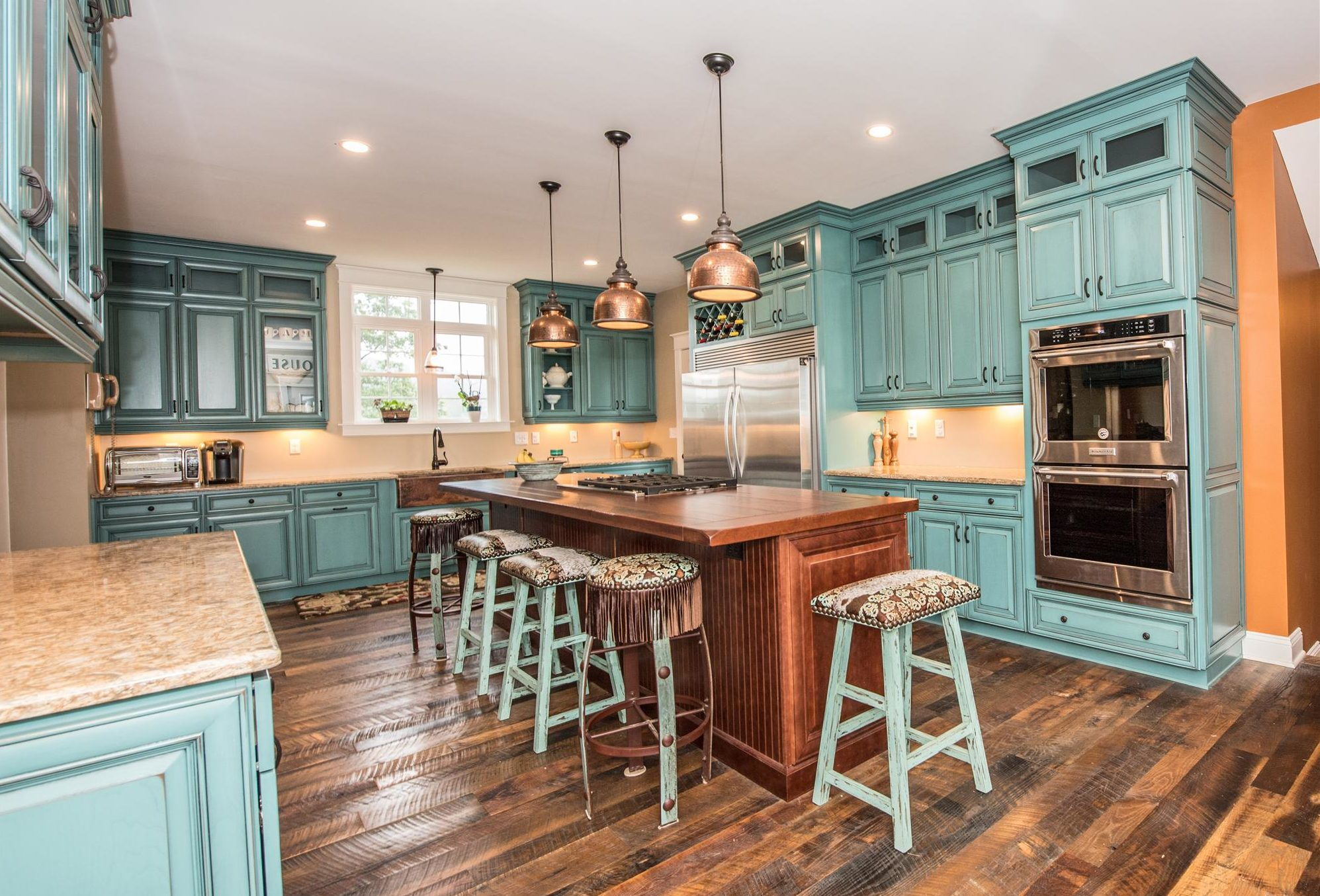 teal-colored kitchen cabinets