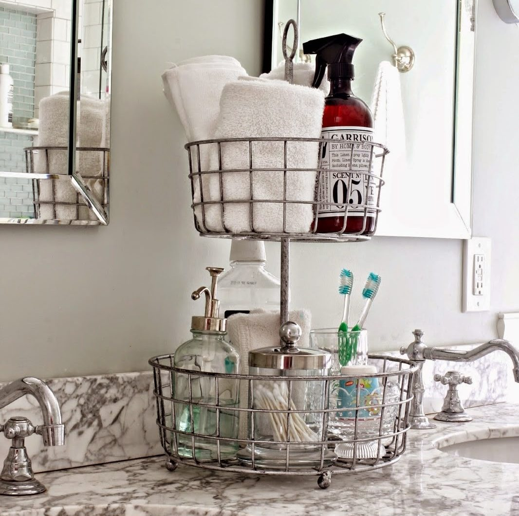 tiered baskets on bathroom counter