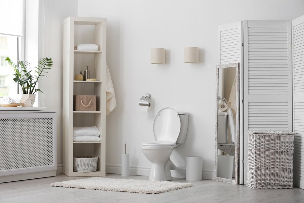 bathroom with corner shelving